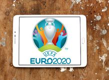 UEFA Euro 2020 logo. Logo of UEFA Euro 2020 on samsung tablet on wooden background. The 2020 UEFA European Football Championship is scheduled to be the 16th Royalty Free Stock Photography