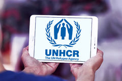 UNHCR , UN Refugee Agency, logo. Logo of UNHCR , UN Refugee Agency, on samsung tablet. UNHCR is a United Nations programme mandated to protect and support stock photography