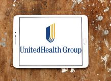 UnitedHealth Group logo. Logo of UnitedHealth Group on samsung tablet on wooden background. UnitedHealth Group Inc. is an American profit managed health care royalty free stock photo