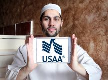 USAA company logo. Logo of USAA company on samsung tablet holded by arab muslim man. The United Services Automobile Association, USAA is a Texas-based Fortune Royalty Free Stock Photos