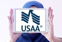 USAA company logo. Logo of USAA company on samsung tablet holded by arab muslim woman. The United Services Automobile Association, USAA is a Texas-based Fortune Royalty Free Stock Photos