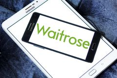 Waitrose Supermarkets chain logo. Logo of Waitrose Supermarkets chain on samsung mobile. Waitrose is a chain of British supermarkets, which forms the food retail Royalty Free Stock Image