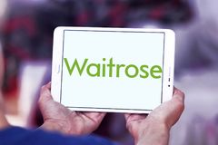 Waitrose Supermarkets chain logo. Logo of Waitrose Supermarkets chain on samsung tablet  . Waitrose is a chain of British supermarkets, which forms the food Stock Photography