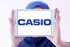 Casio watchmaker logo. Logo of watchmaker company casio on samsung tablet holded by arab muslim woman Royalty Free Stock Photo