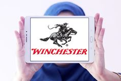 Winchester Repeating Arms Company logo. Logo of Winchester Arms Company on samsung tablet holded by arab muslim woman. The Winchester Repeating Arms Company is a Stock Image