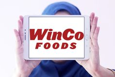 WinCo Foods logo. Logo of WinCo Foods on samsung tablet holded by arab muslim woman. WinCo Foods, Inc. is a privately held, majority employee-owned American Stock Image