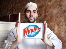 Windex cleaner brand logo. Logo of Windex cleaner brand on samsung tablet holded by arab muslim man. Windex is a glass and hard surface cleaner stock photos