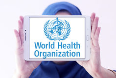 World Health Organization, WHO, logo. Logo of World Health Organization on samsung tablet holded by arab muslim woman. The World Health Organization WHO is a stock image