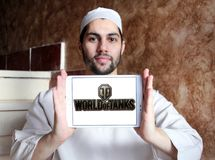 World of Tanks game logo. Logo of World of Tanks game on samsung tablet holded by arab muslim man. World of Tanks WoT is a massively multiplayer online game royalty free stock images