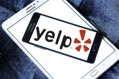 Yelp company logo. Logo of Yelp on samsung mobile. Yelp is an American multinational corporation. It develops, hosts and markets Yelp.com and the Yelp mobile app Royalty Free Stock Photography