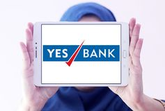 Yes Bank logo. Logo of Yes Bank on samsung tablet holded by arab muslim woman. Yes Bank is India`s fourth largest private sector bank Stock Photography