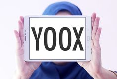 YOOX Fashion brand logo. Logo of YOOX Fashion brand on samsung tablet holded by arab muslim woman. YOOX is the world`s leading online lifestyle store for Fashion royalty free stock photography