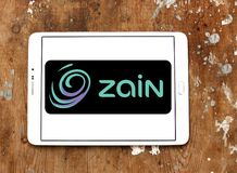 Zain telecommunications company logo. Logo of Zain telecommunications company on samsung tablet. it is a mobile telecommunications company founded in 1983 in Royalty Free Stock Images