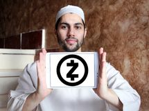 Zcash cryptocurrency logo. Logo of Zcash cryptocurrency on samsung tablet holded by arab muslim man. Zcash is a cryptocurrency that grew out of the Zerocoin royalty free stock photography