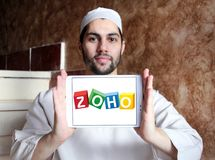 Zoho Corporation logo. Logo of Zoho Corporation on samsung tablet holded by arab muslim man. Zoho Corporation is an information technology and business Stock Photos