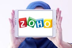 Zoho Corporation logo. Logo of Zoho Corporation on samsung tablet holded by arab muslim woman. Zoho Corporation is an information technology and business Royalty Free Stock Photography