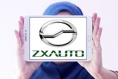 ZX Auto company logo. Logo of ZX Auto company on samsung tablet holded by arab muslim woman. ZX Auto, is a smaller Chinese producer of SUVs and pick-up trucks stock image