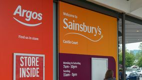 Logos of Argos and Sainsbury`s Castle Court. Bristol, England - May 28, 2018: Logos of Argos and Sainsbury`s Castle Court, shallow depth of field Stock Photos