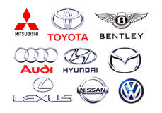 Logos collection of different brands of cars. KIEV, UKRAINE - June 7, 2015: Logos collection of different brands of cars, printed on paper and placed on white Stock Images