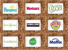 Logos e marche dei produttori dei pannolini Fotografia Stock