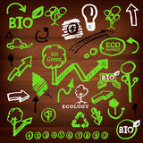 Logos and eco signs. The illustration of different logos and eco signs on a dark wooden texture. Vector image Royalty Free Stock Photos