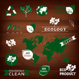 Logos and eco signs. The illustration of different logos and eco signs od a dark wooden texture. Vector image Stock Image