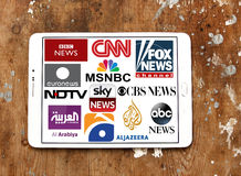 Logos of top famous tv news channels. Collection of logos and vectors of most popular news television networks in the world on white tablet on rusty wooden stock photo
