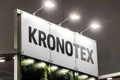 Logotecken av det Kronotex företaget Kronotex producerar laminatdurken Royaltyfri Fotografi