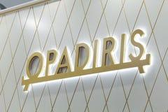 Logotecken av det Opadiris företaget Opadiris är en producent av sanitära produkter och badmöblemang Royaltyfri Fotografi