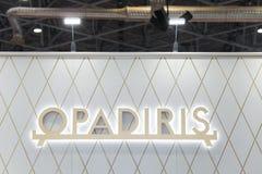 Logotecken av det Opadiris företaget Opadiris är en producent av sanitära produkter och badmöblemang Royaltyfri Bild