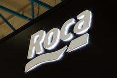 Logotecken av det Roca företaget Roca är en spansk producent av sanitära produkter Arkivfoton