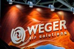 Logotecken av det Weger företaget Weger är en ledare i marknaden av luft som behandlar enheter Fotografering för Bildbyråer