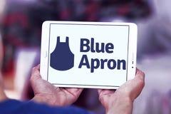 Logotipo azul del servicio del equipo de la comida del delantal foto de archivo libre de regalías