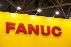 Logotipo da empresa de Fanuc na parede Fotografia de Stock Royalty Free