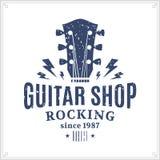 Logotipo da loja da guitarra ilustração stock