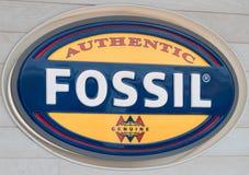 Logotipo da loja fóssil da roupa no foto de stock royalty free