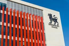 Logotipo da universidade municipal de Birmingham, Reino Unido Imagens de Stock Royalty Free