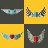 Logotipo das asas para a empresa no fundo amarelo e marrom Imagens de Stock