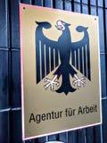 Logotipo de Arbeit de la piel de Agentur del alemán fotografía de archivo libre de regalías