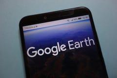 Logotipo de Google Earth en smartphone imagen de archivo libre de regalías