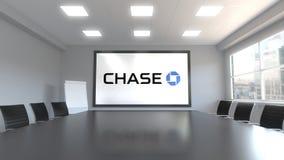 Logotipo de JPMorgan Chase Bank en la pantalla en una sala de reunión Representación editorial 3D Fotografía de archivo