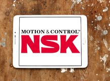 Logotipo de la compañía de NSK imagen de archivo