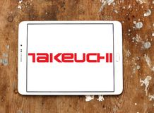 Logotipo de la compañía de Takeuchi Manufacturing foto de archivo