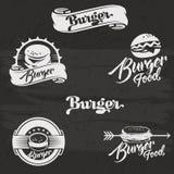 Logotipo de las hamburguesas fijado en estilo del vintage Mano retra Imágenes de archivo libres de regalías