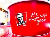 Logotipo de marcado en caliente de KFC Kentucky Fried Chicken con el ` del lema él ` del ` del lickin del finger del ` s buen Imagen de archivo libre de regalías