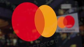 Logotipo de Mastercard sobre el vidrio contra centro de negocios borroso Representación editorial 3D Fotografía de archivo