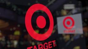 Logotipo de Target Corporation sobre el vidrio contra centro de negocios borroso Representación editorial 3D Foto de archivo
