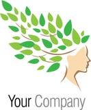 Logotipo del árbol de la mujer Foto de archivo libre de regalías