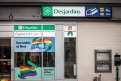 Logotipo del banco de Desjardins en su rama para el distrito gay le Village, con lema amistoso de LGBT imágenes de archivo libres de regalías