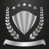 Logotipo del metal Escudo, estrellas, guirnalda del laurel y bandera Imagen de archivo